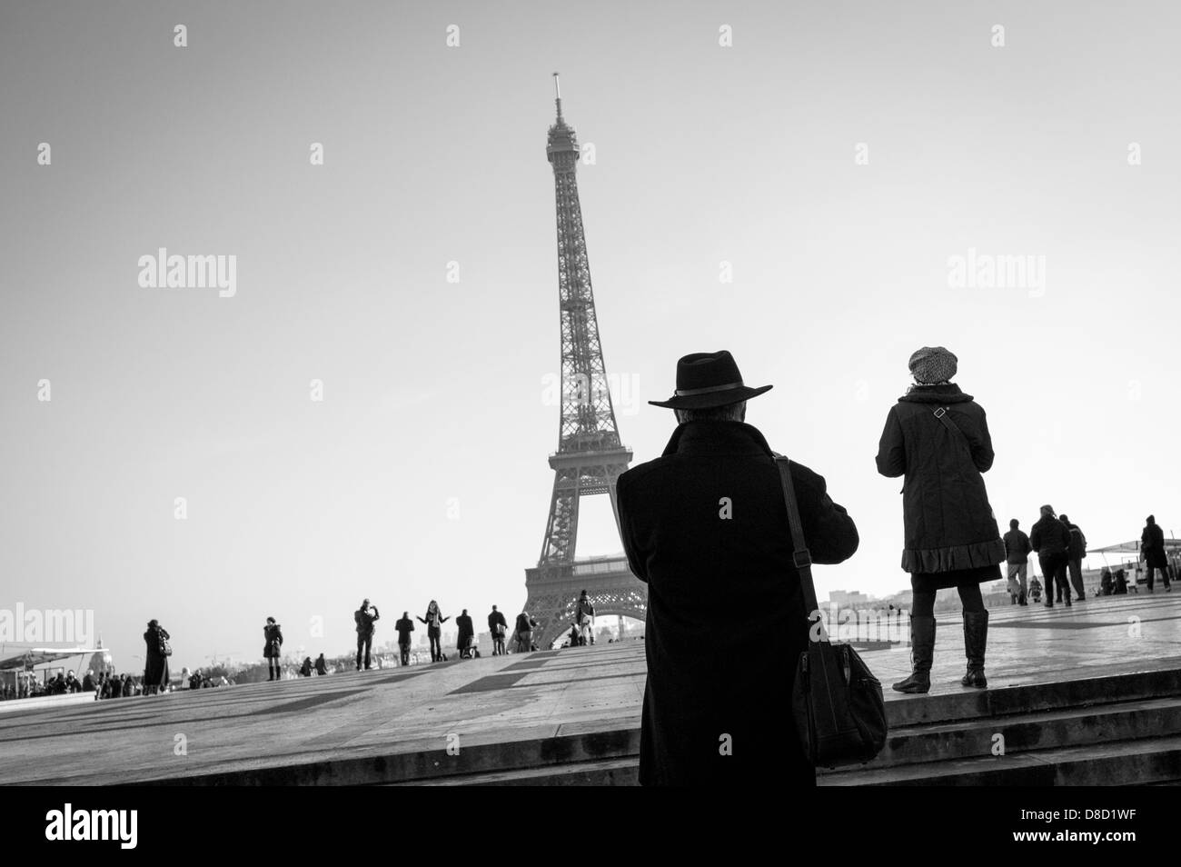 Tourists photographing The Eiffel Tower from Place du Trocadéro in Paris, France. - Stock Image