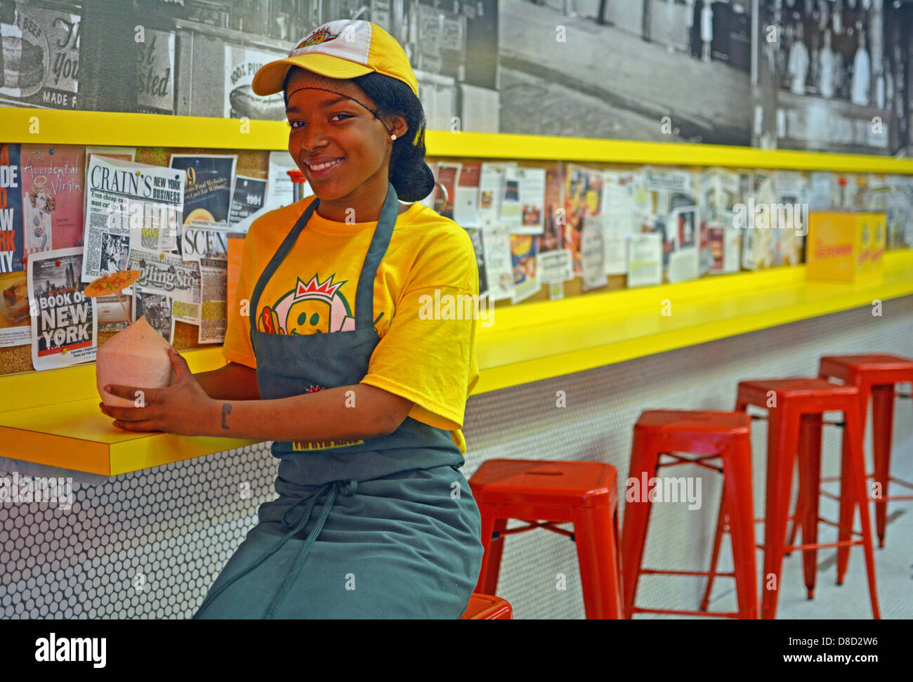 Portrait of Jade, a counter girl at Papaya King on St. Marks Place in the East Village section of New York City - Stock Image