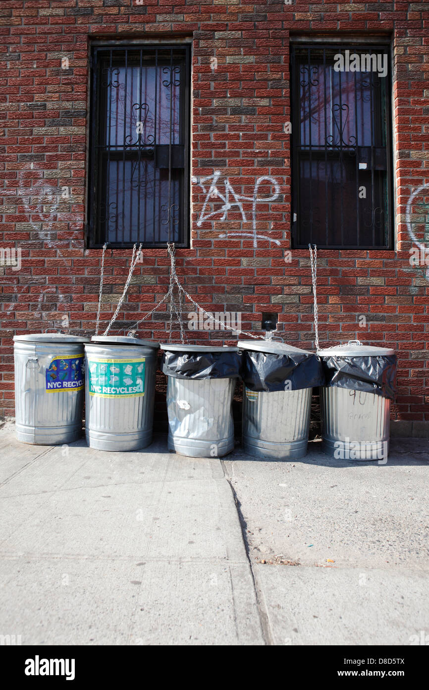 garbage cans on sidewalk - Stock Image