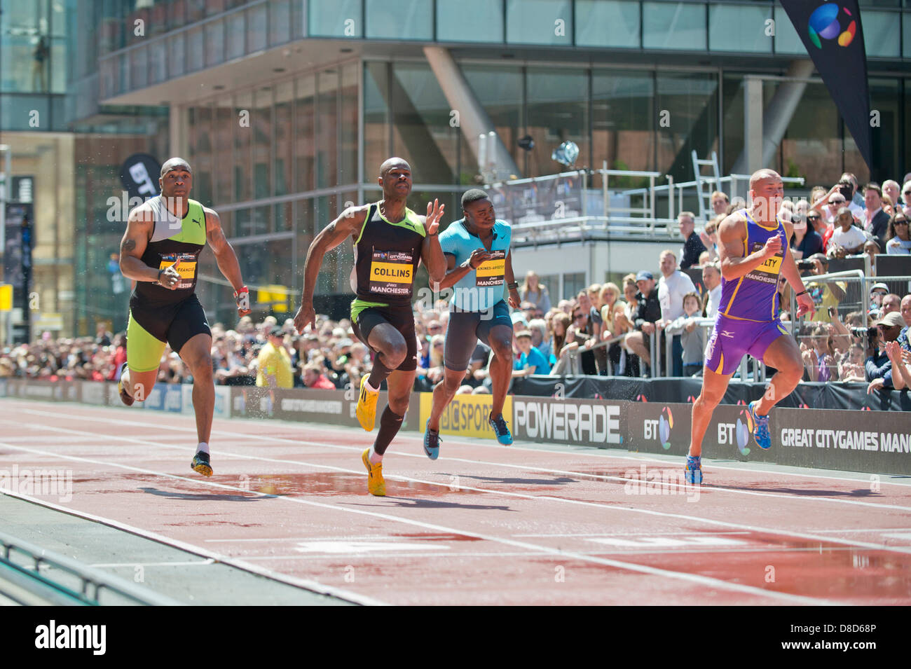 MANCHESTER, UK. 25th May 2013. Kim Collins (second left) of Saint Kitts and Nevis sprints to take 1st place during - Stock Image