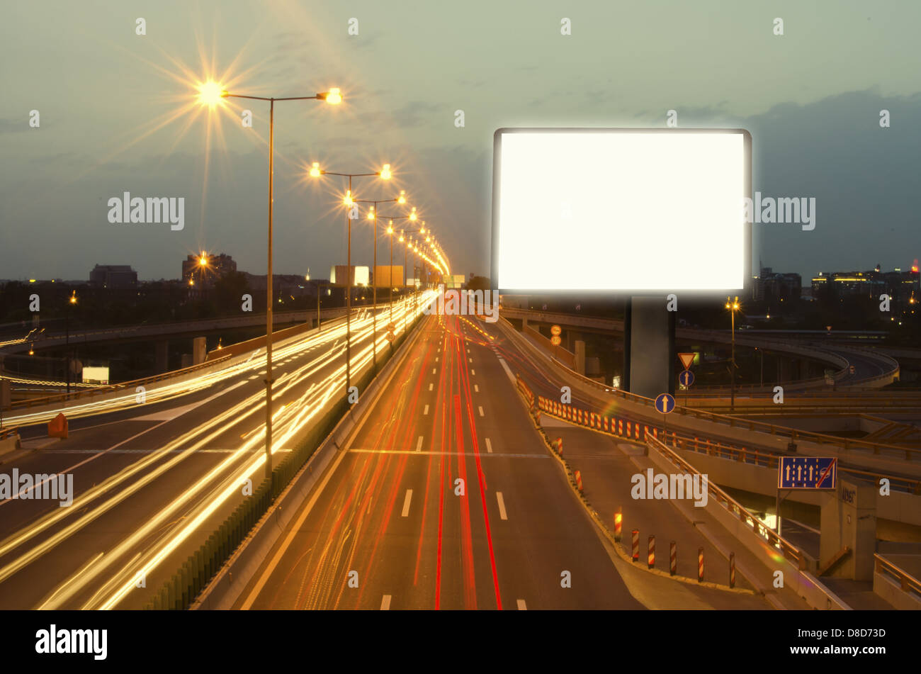 Empty billboard on the highway at night.A long exposure. - Stock Image