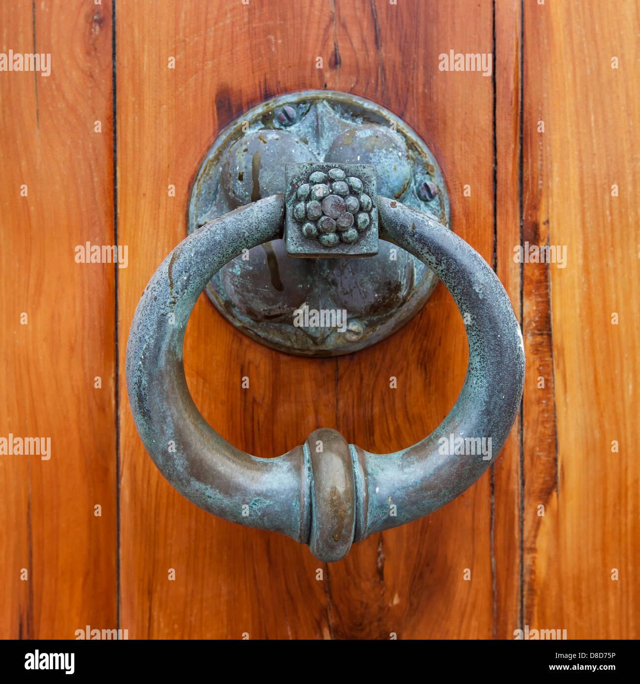 Antique door pull or door knocker on the front cedar door of St. Peter's Anglican Church, in St. George's, - Stock Image