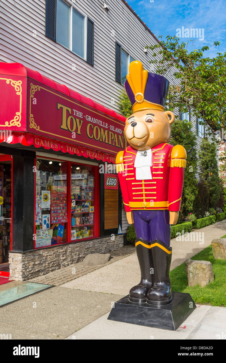 Toy soldier bear outside Granville Island Toy Company store, Vancouver, British Columbia, Canada - Stock Image