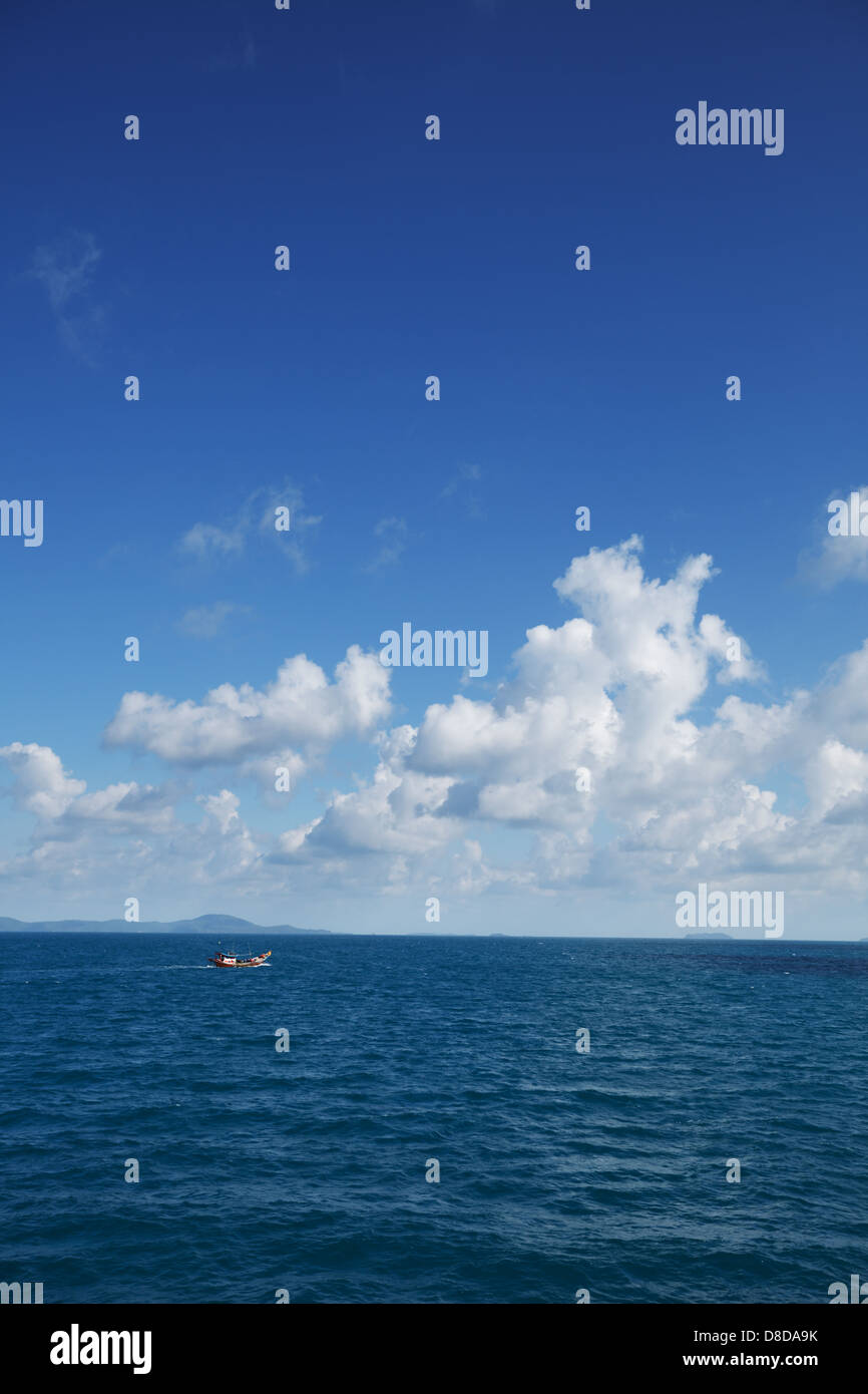 Small old fishing boat in the ocean. Thailand Stock Photo