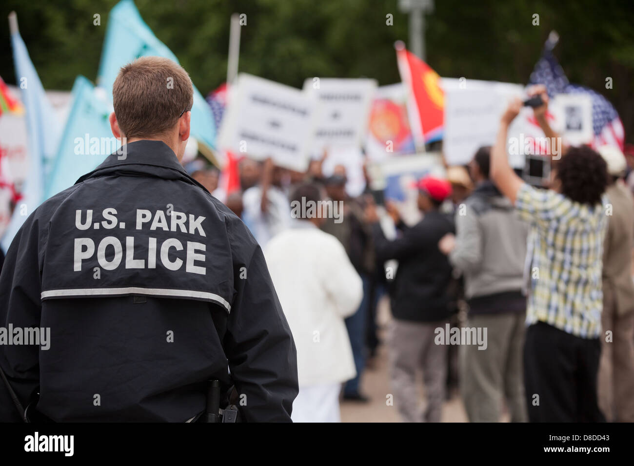 US Park Policeman monitoring demonstrators - Washington, DC USA - Stock Image