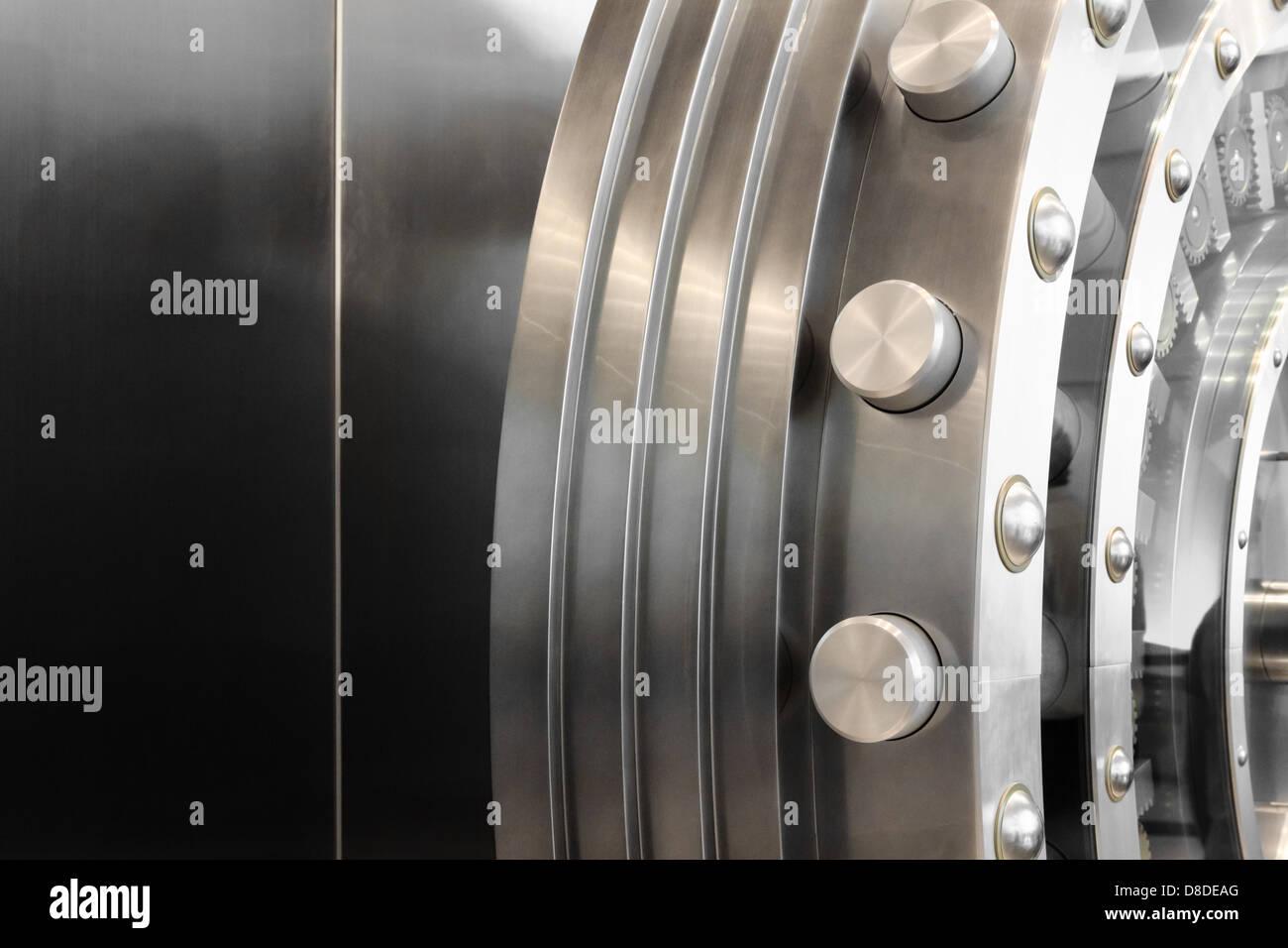 An open safe door in a vault - Stock Image