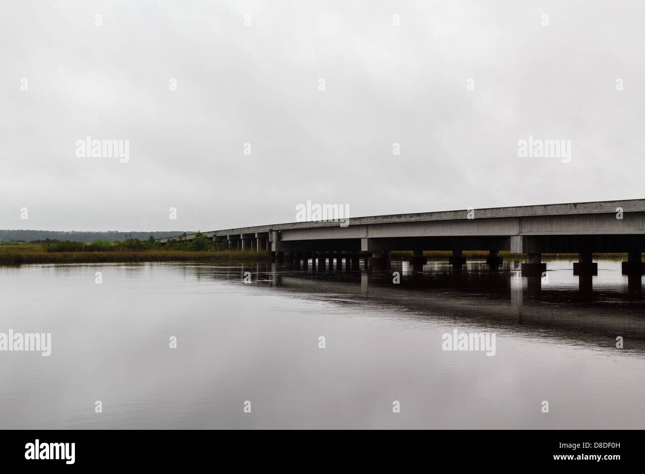 A bridge over a river in the US on a sullen fall day - Stock Image