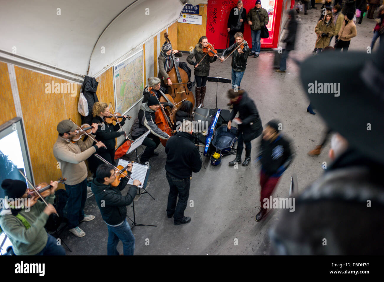 Orchestra playing in the Paris Metro. - Stock Image