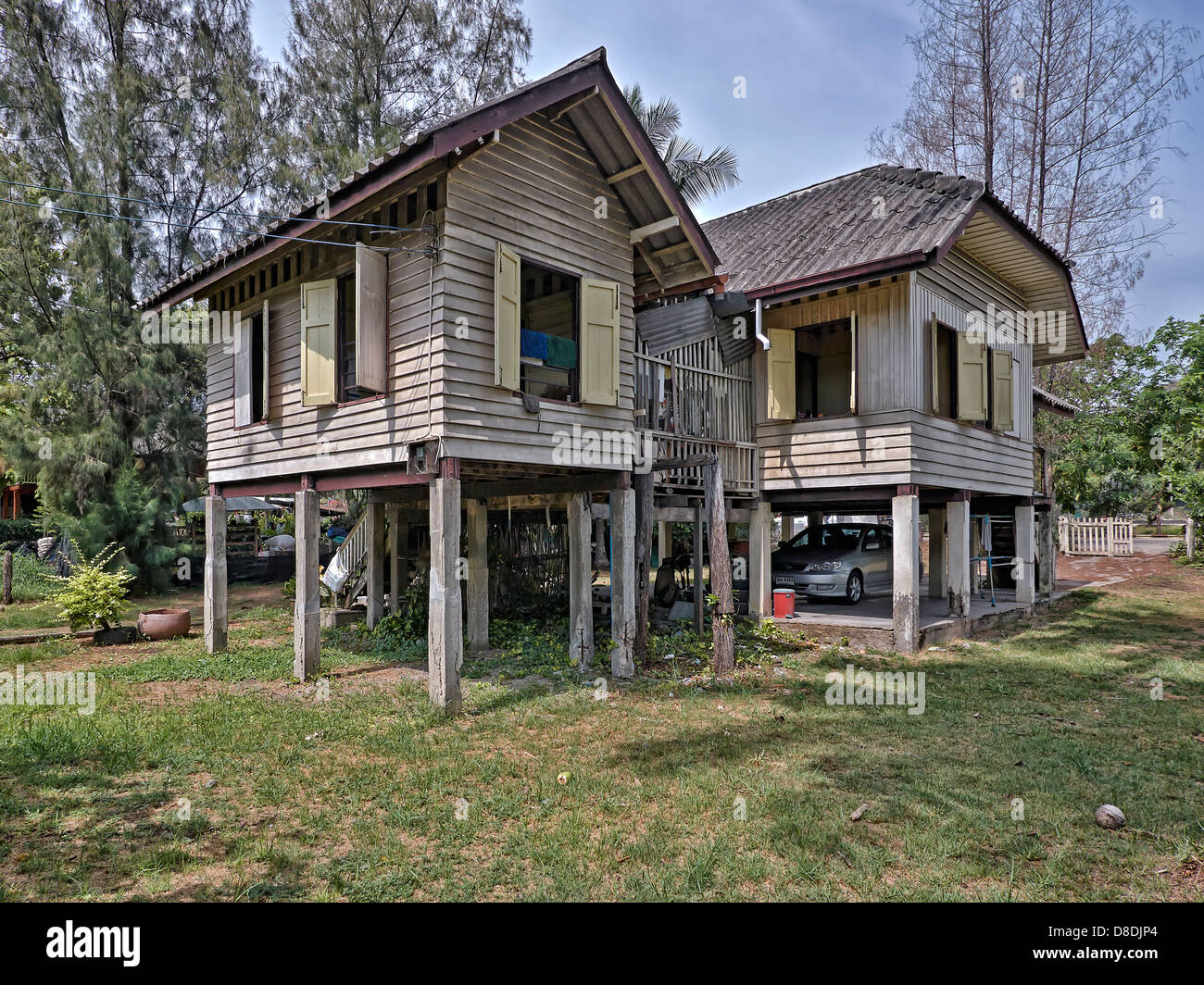 Traditional Thai Wooden House On Stilts With Car Parked Beneath. Thailand  S. E. Asia