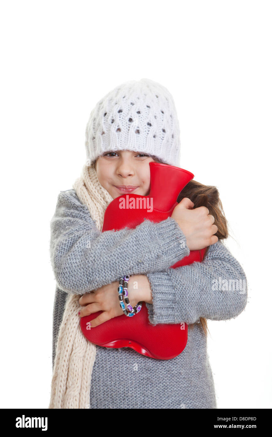 cold winter kid or child with hot water bottle - Stock Image