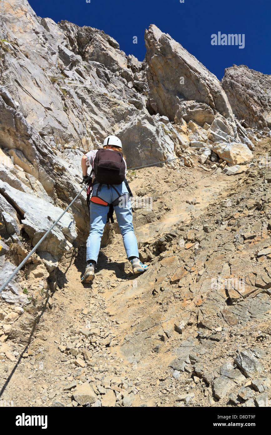 female climber on Bepi Zac via ferrata, italian Dolomites Stock Photo