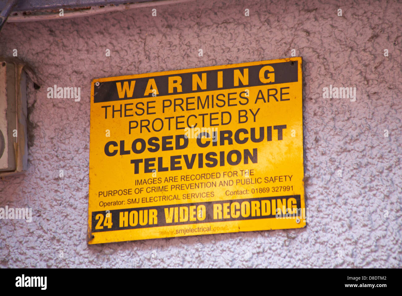 warning these premises are protected by closed circuit television sign on wall at Oxford in May - Stock Image