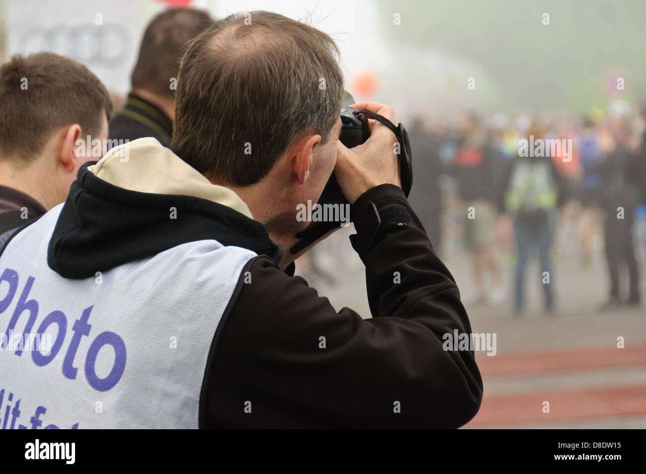 Official accredited professional photographer photographing a public event - Stock Image