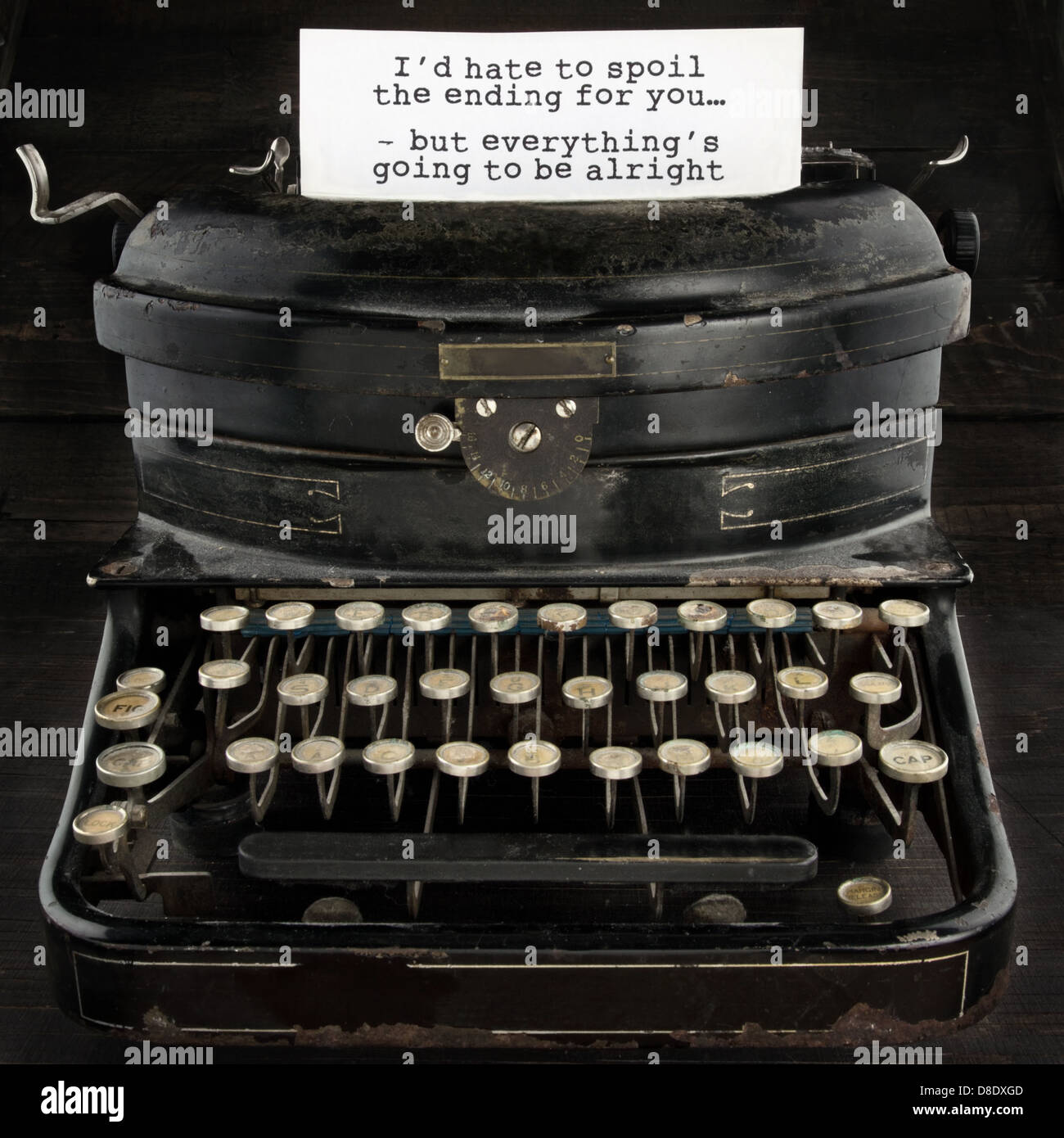 Old black antique vintage typewriter with inspirational quote - Stock Image