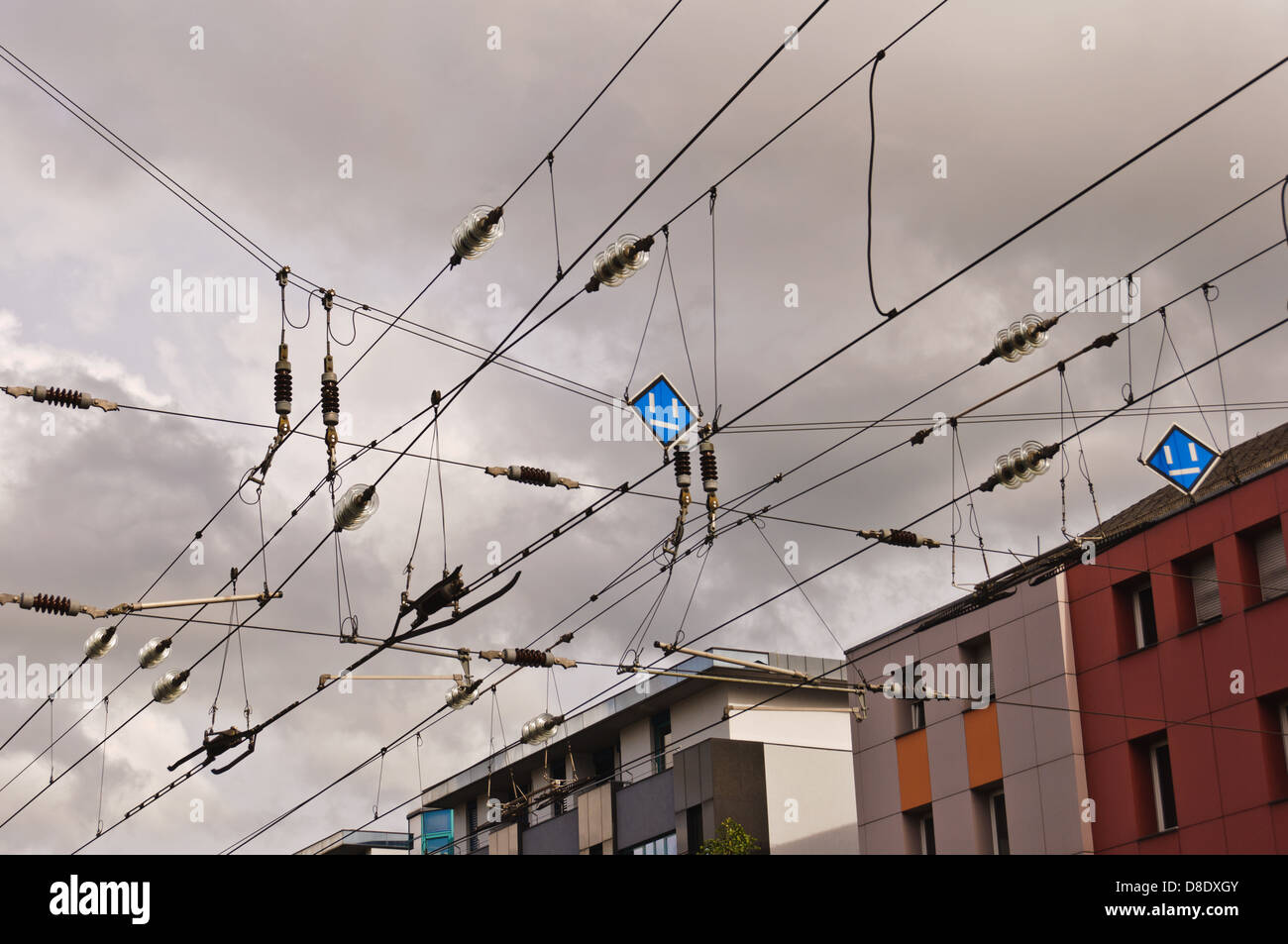 Catenary, contact wires, against thunderstorm and rain clouds Stock Photo