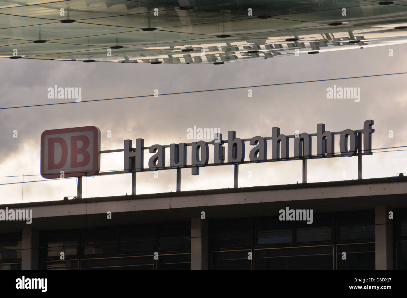 DB Hauptbahnhof sign on the roof of the main railway station of the German city Heilbronn Germany on a overcast - Stock Image
