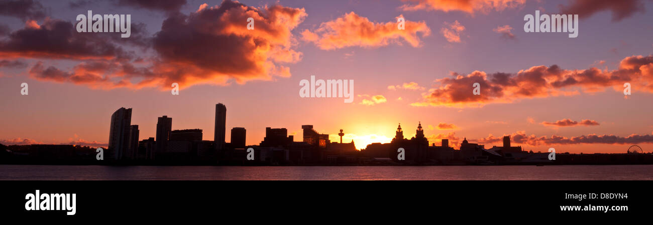 Liverpool Skyline at sunrise. Shot is taken from the opposite bank of the River Mersey at Seacombe - Stock Image