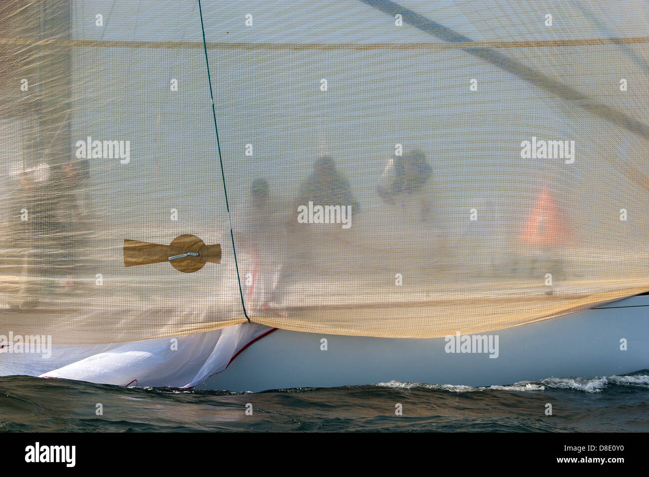 The crew do a headsail change on a twelve meter Americas Cup sailing boat racing in Narragansett Bay in Rhode Island - Stock Image