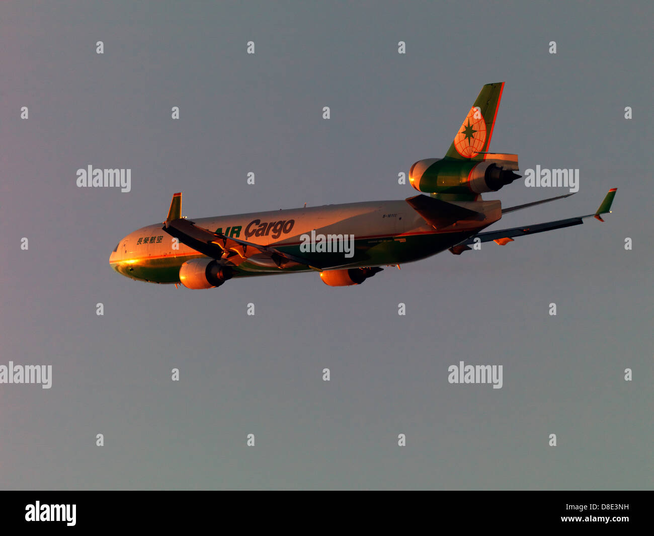 Eva Air Cargo MD-11 flying into the sunset - Stock Image