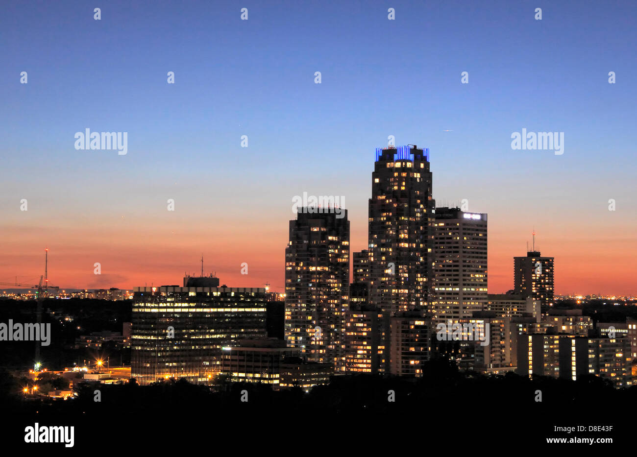 Toronto, Canada. May 26, 2013. Conjunction of Venus, Jupiter and Mercury in triangle above buildings in Yonge and - Stock Image