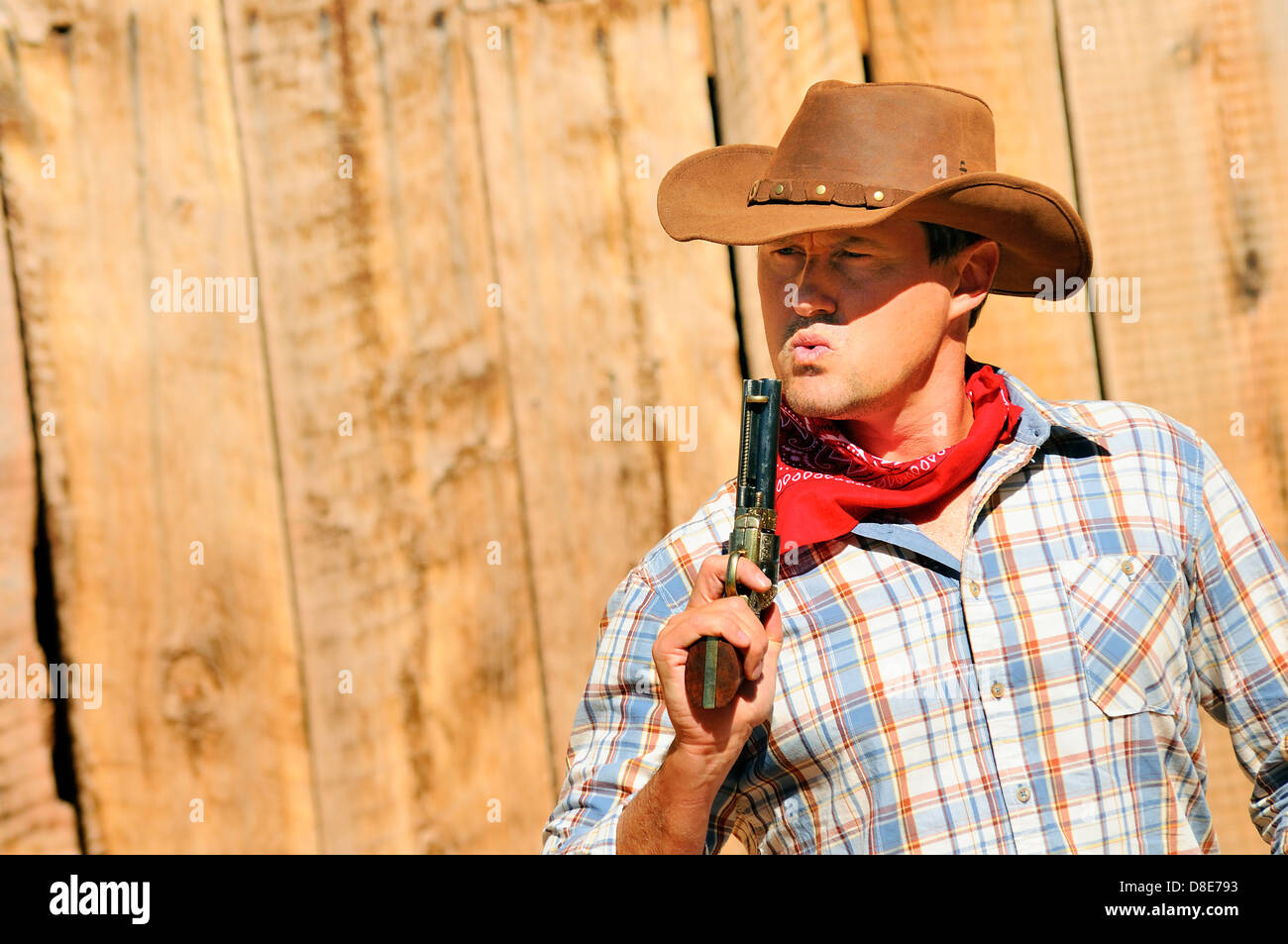 SOUTHWEST - A cowboy takes time to rest and reflect. - Stock Image