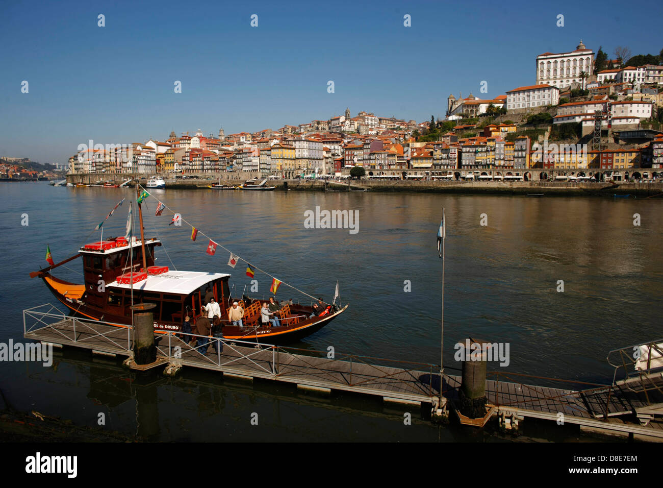Port wine sip on River Douro, Porto, Portugal - Stock Image