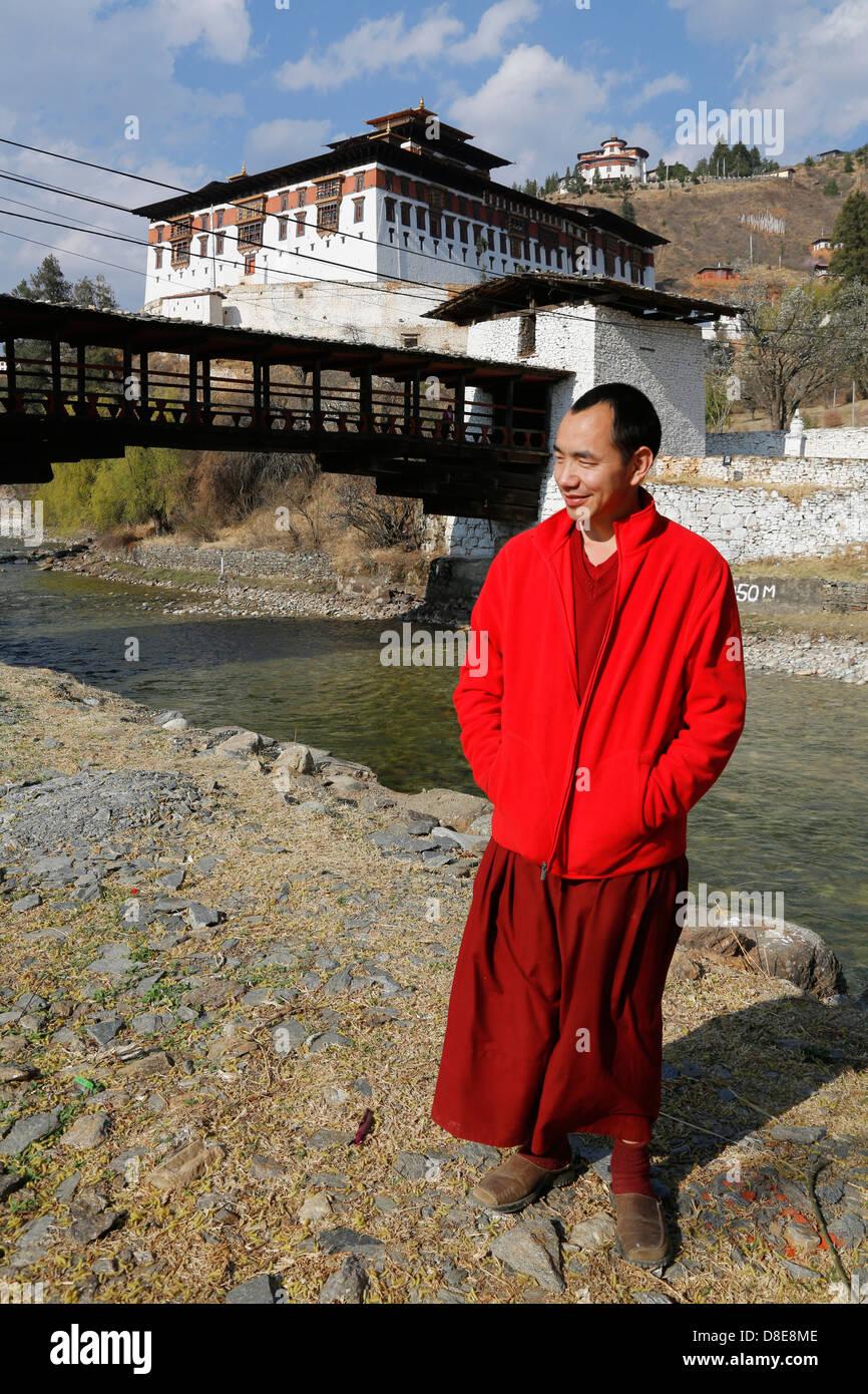 Monk in front of monastery, Paro, Bhutan, Asia Stock Photo
