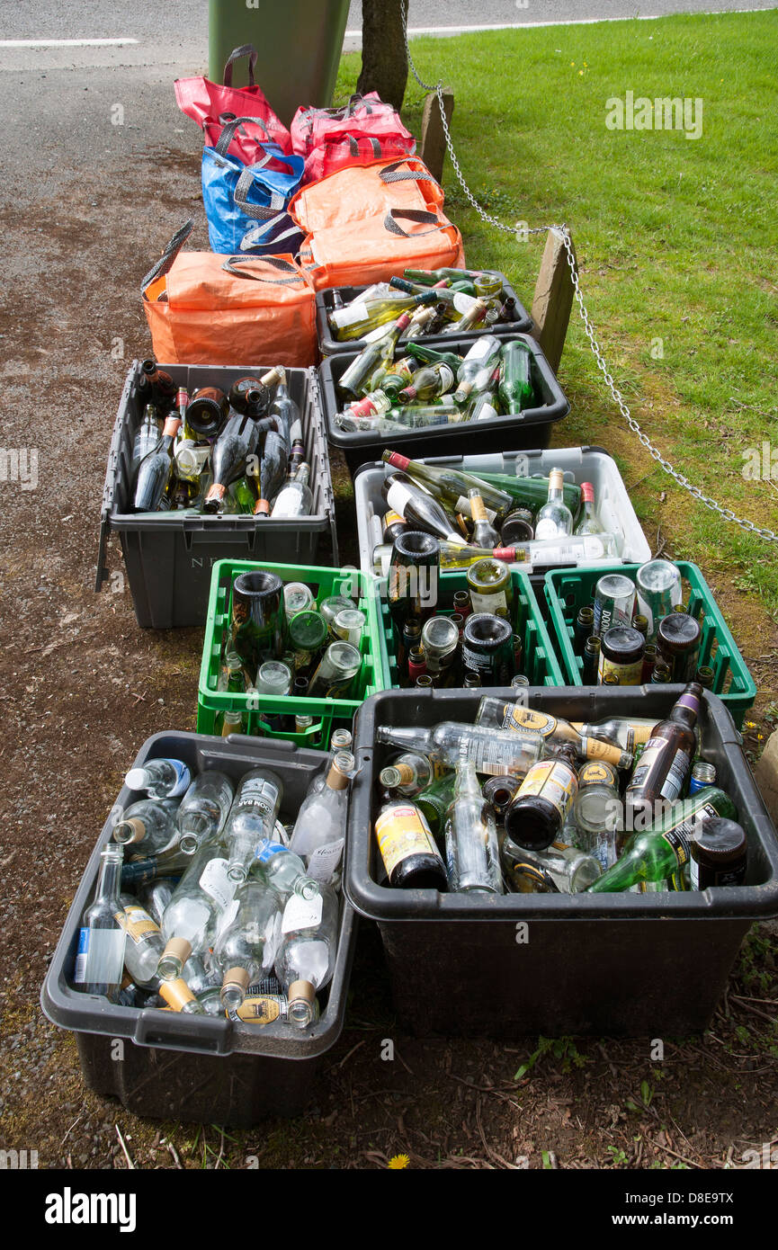 Recyclables empty bottles await collection - Stock Image