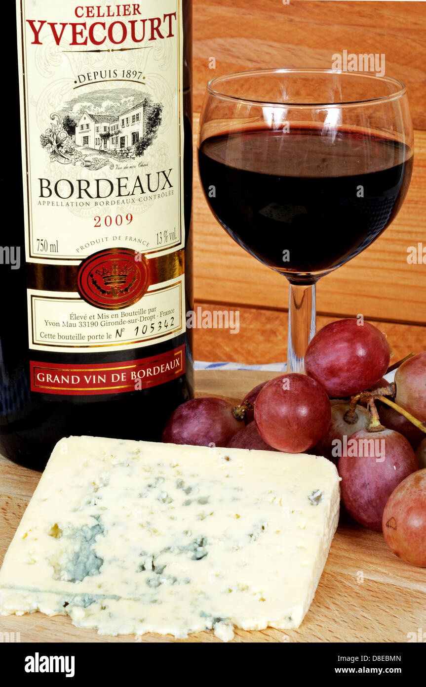 Bleu Dauvergne Cheese Red Wine And Red Grapes On A Wooden Cheese