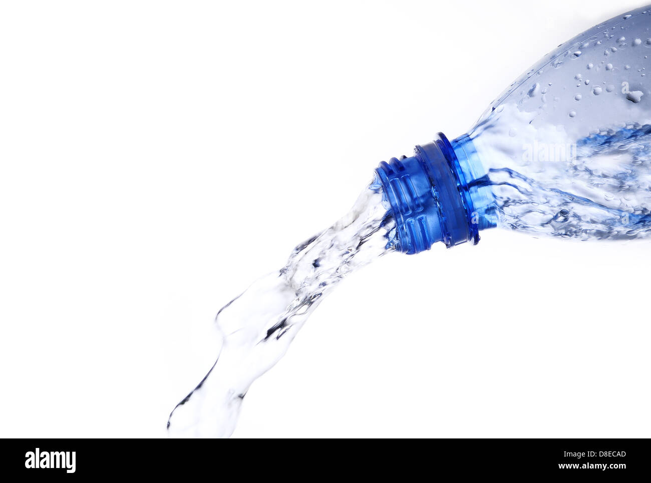 pouring water from water bottle - Stock Image
