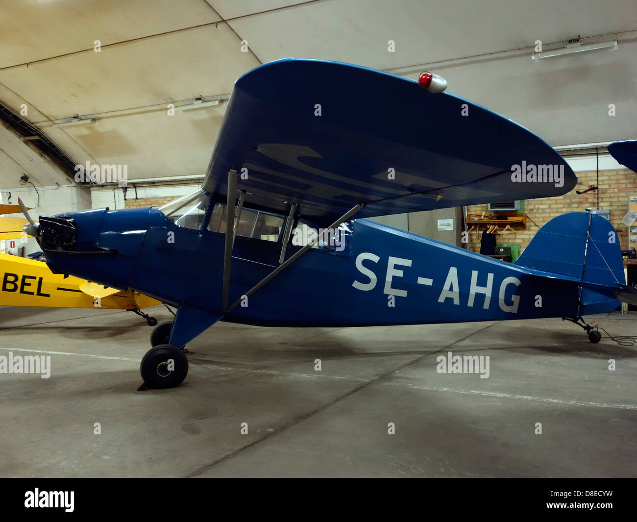 Old highwing two-seated monoplane - Stock Image