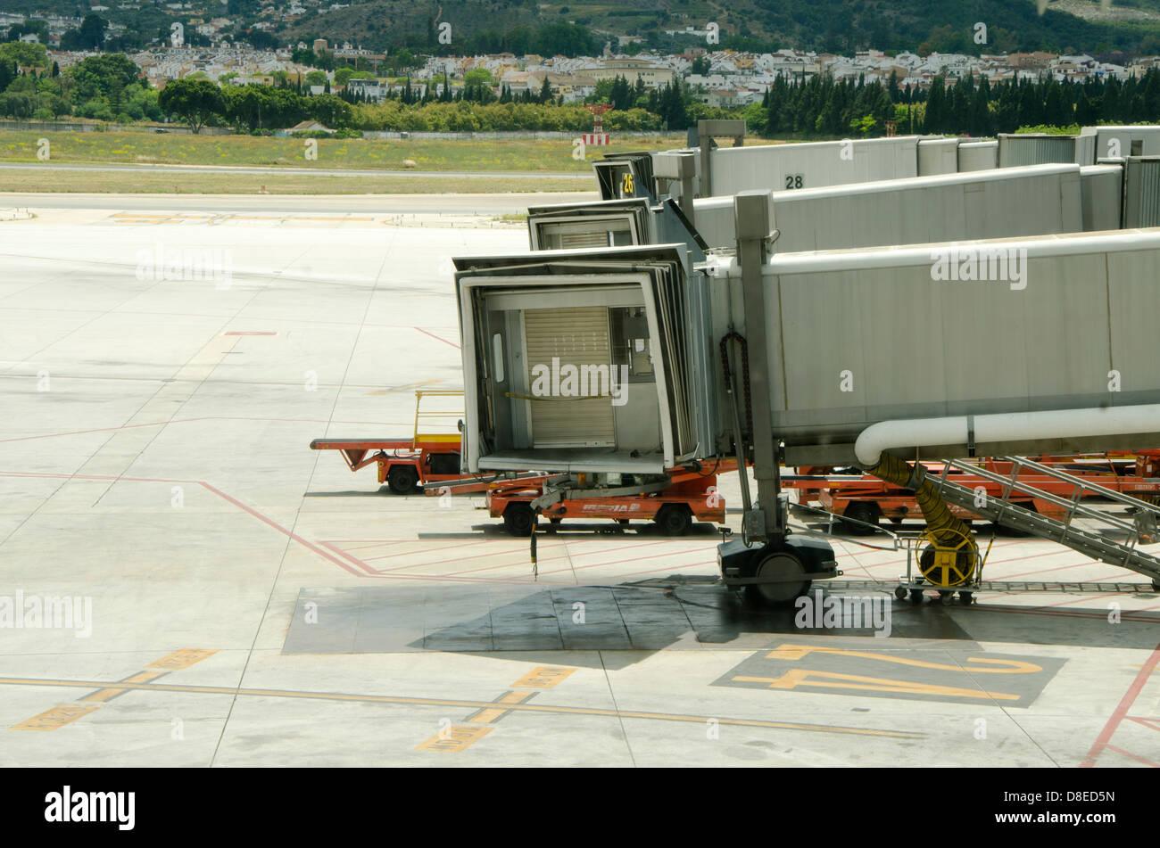 Boarding bridges to embark at airport of Malaga, Costa del Sol, Spain. - Stock Image