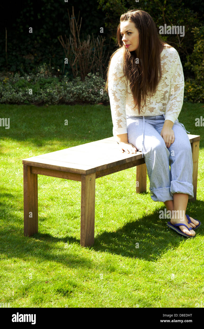 Woman Sitting On Garden Bench Stock Photo 56866372 Alamy