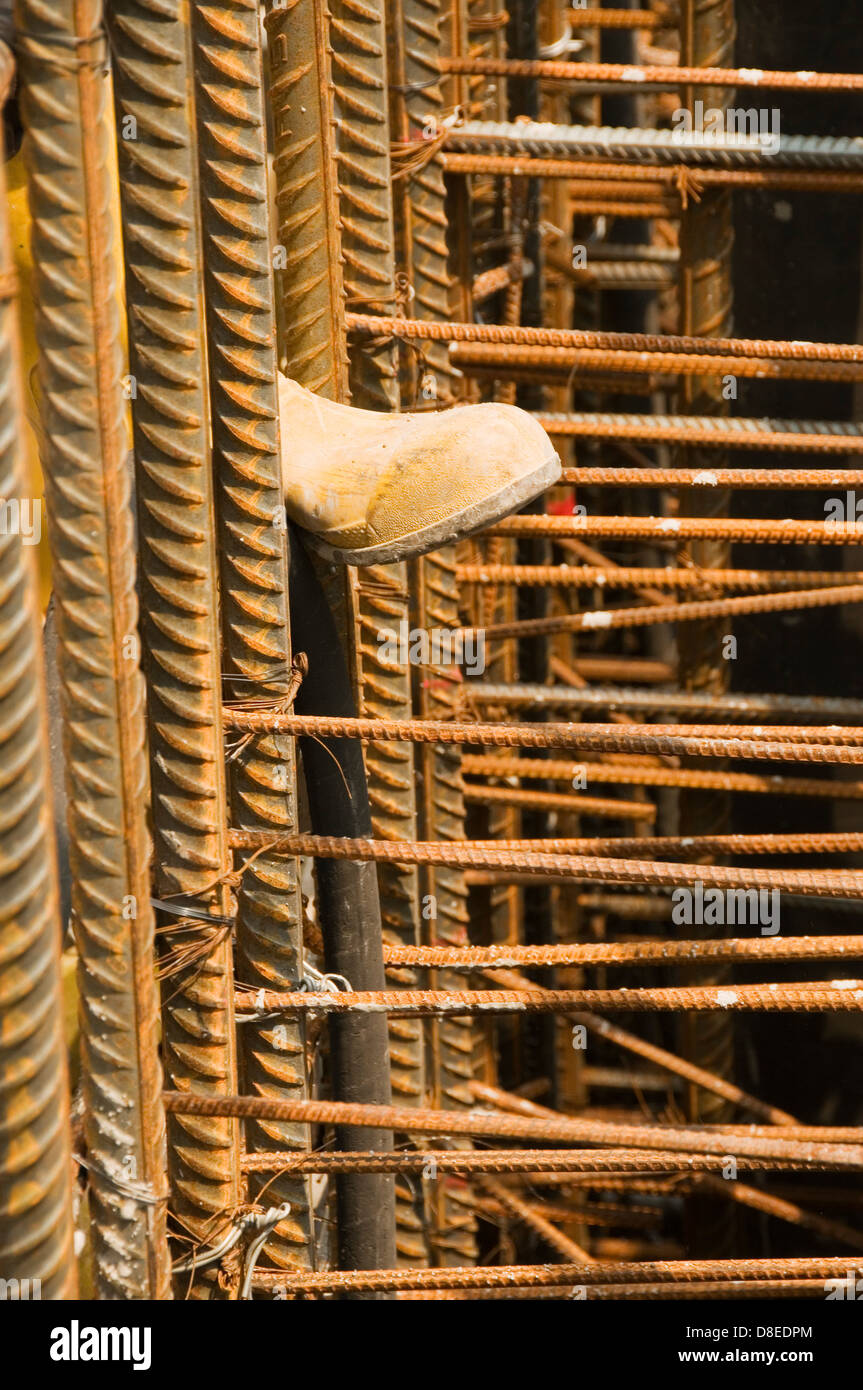 Workers Boot and Steel Supports on Building Site Stock Photo