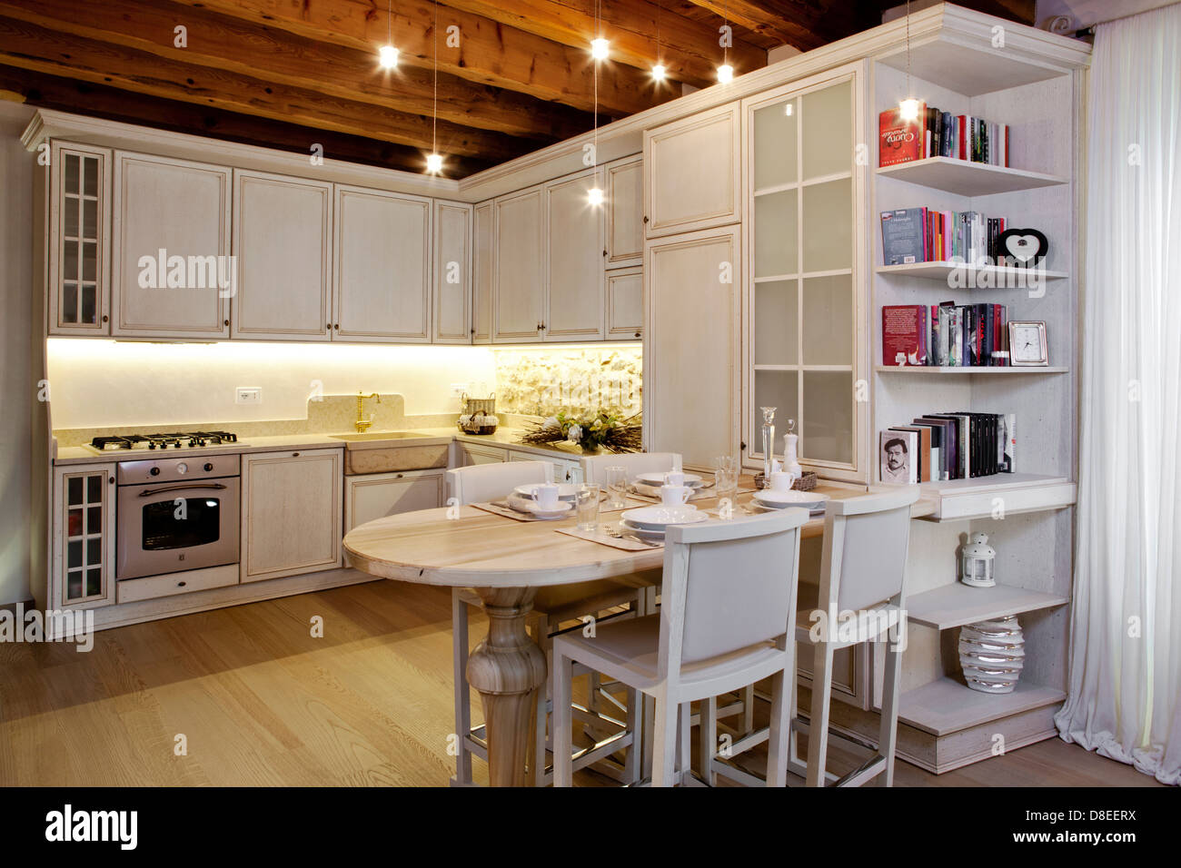 kitchen in old style with modern accessories - Stock Image