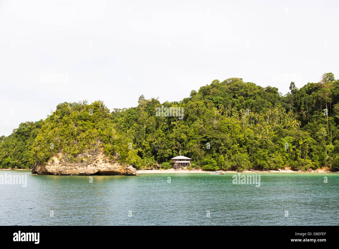 An isolated beach in the Togians island in Sulawesi, Indonesia - Stock Image