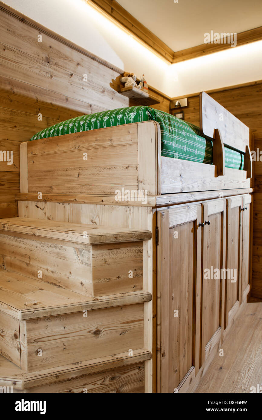 Kid's room in alpine cottage made out of pine wood - Stock Image