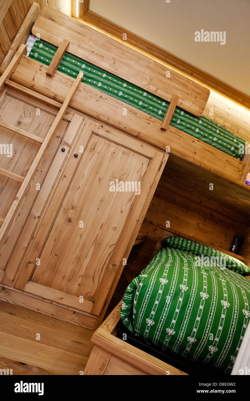 Tiny mountain cottage bedroom for kids in pine wood - Stock Image