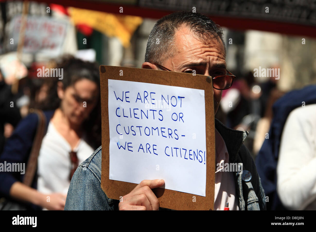 We are not clients or customers we are citizens anti government placard at May Day rally in central London 2013 - Stock Image