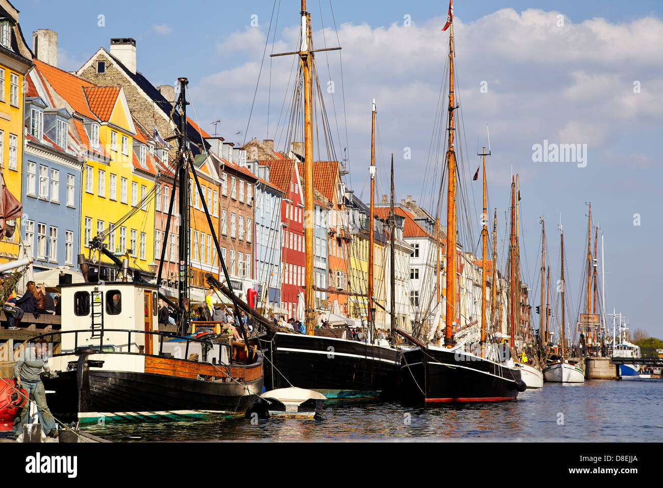 Nyhavn, a central canal and port in Copenhagen, is lined by 17th and early 18th century townhouses and restaurants. - Stock Image