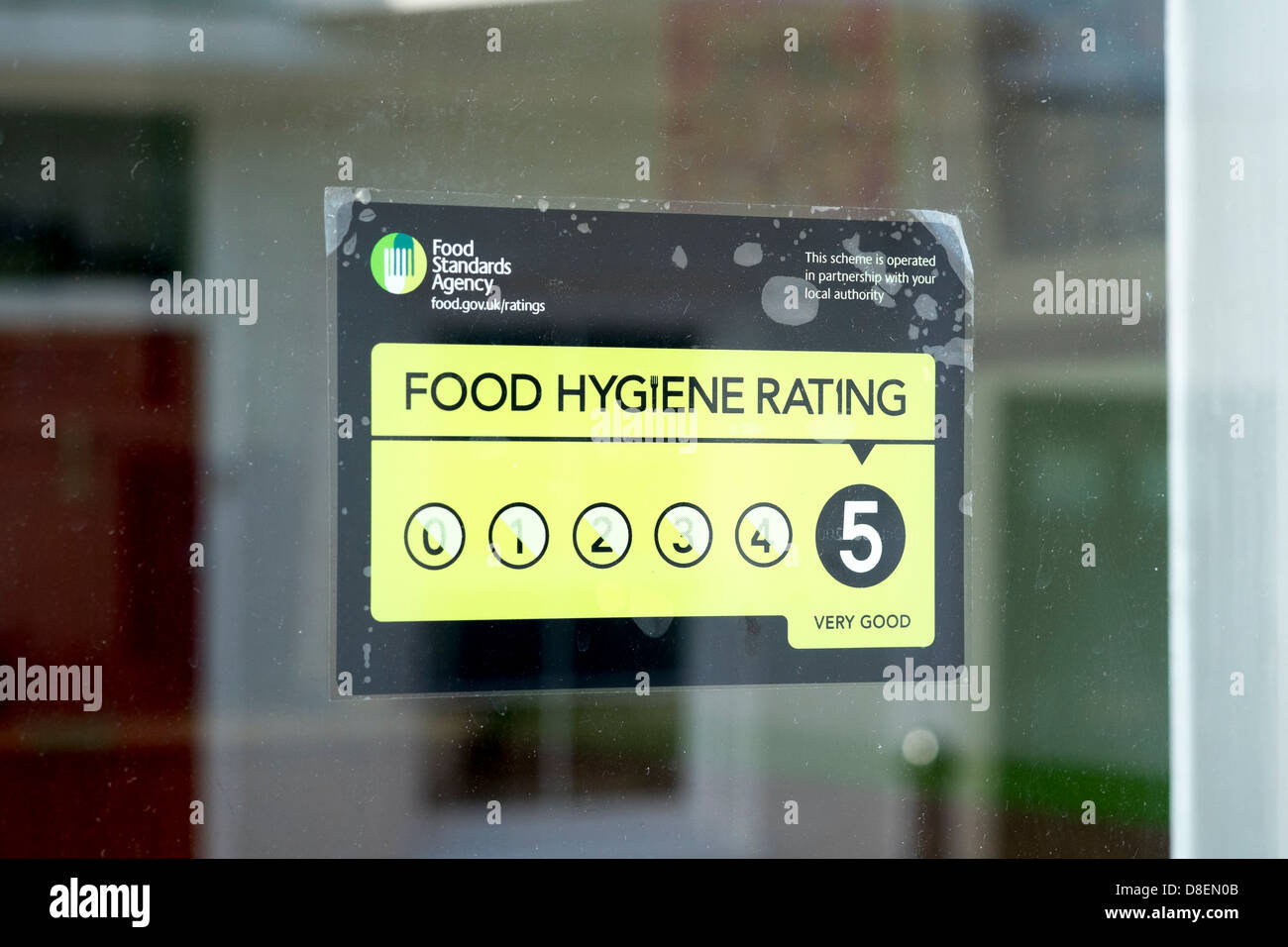 Food Hygiene Rating Sticker In The Window Of A Uk Restaurant