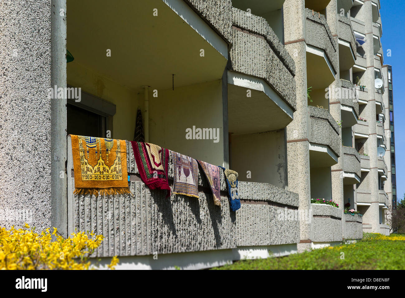 Berlin, Germany, carpets were laid out to dry over the Balkonbruestung - Stock Image