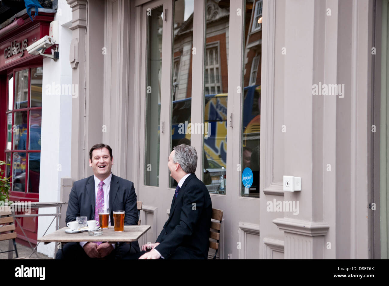 executives socialising with lagers, London, England, UK, GB - Stock Image