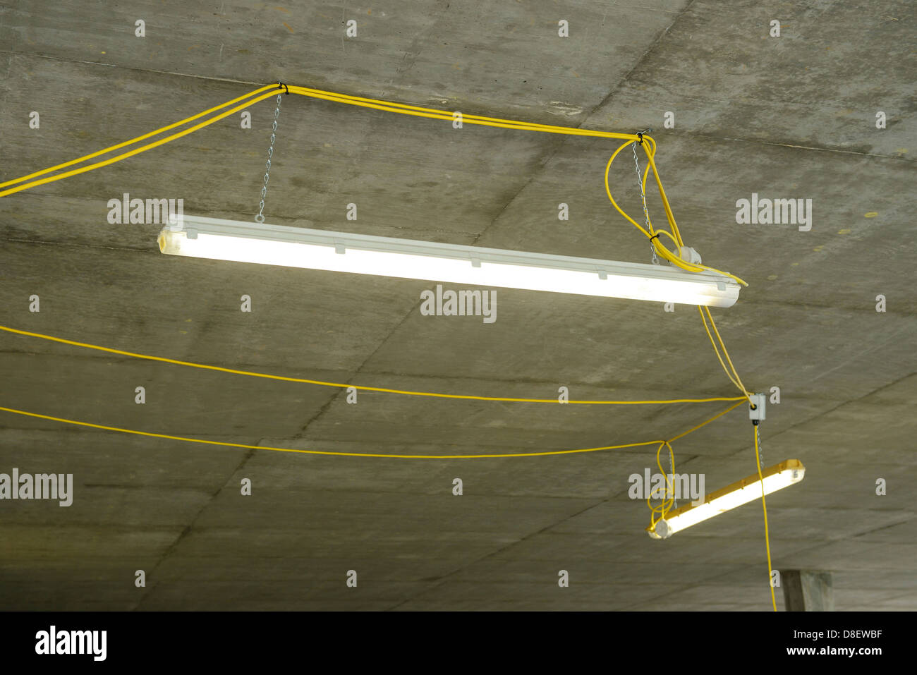 Temporary strip lighting on a construction site - Stock Image