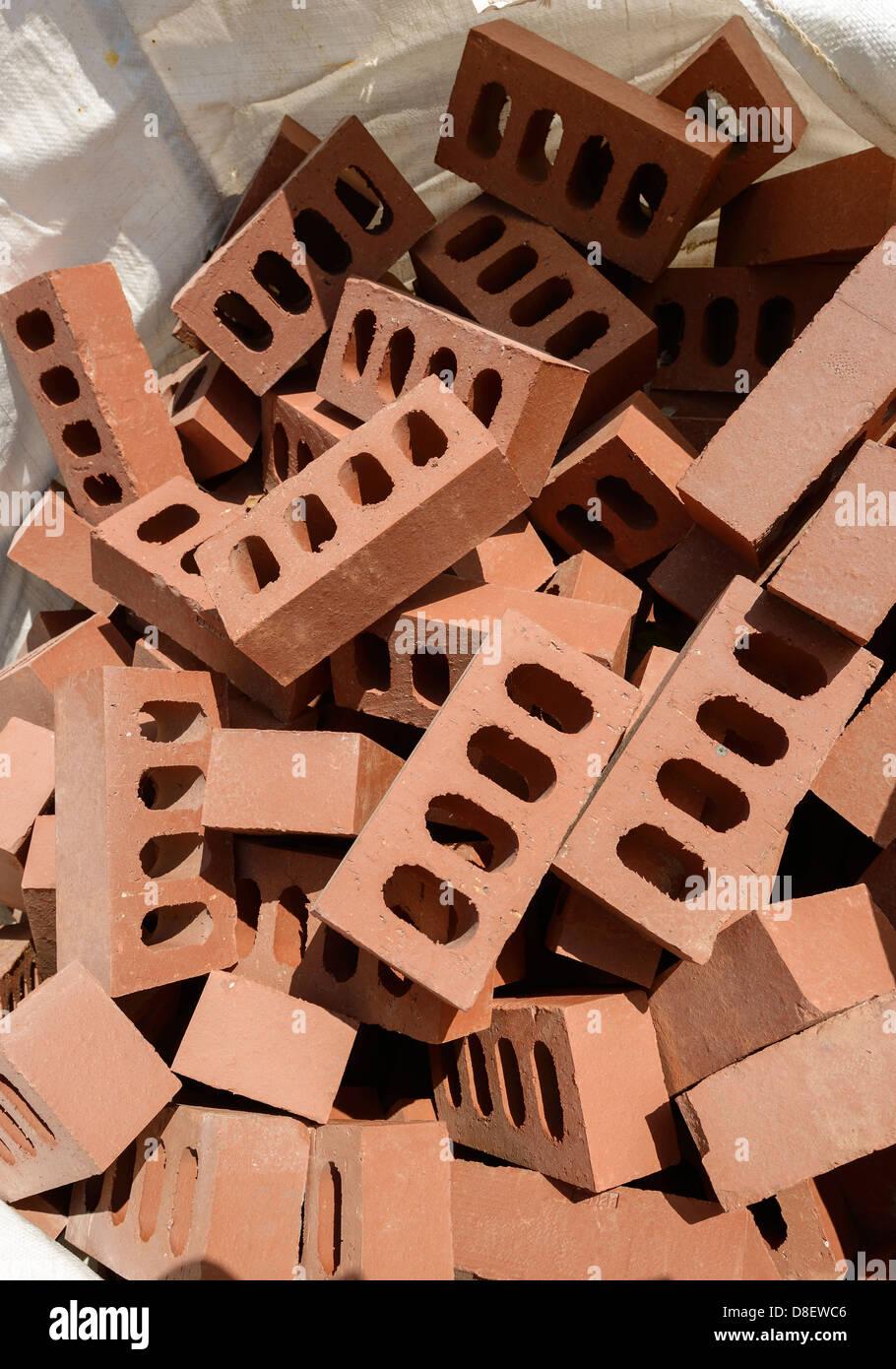 Bag of house bricks - Stock Image
