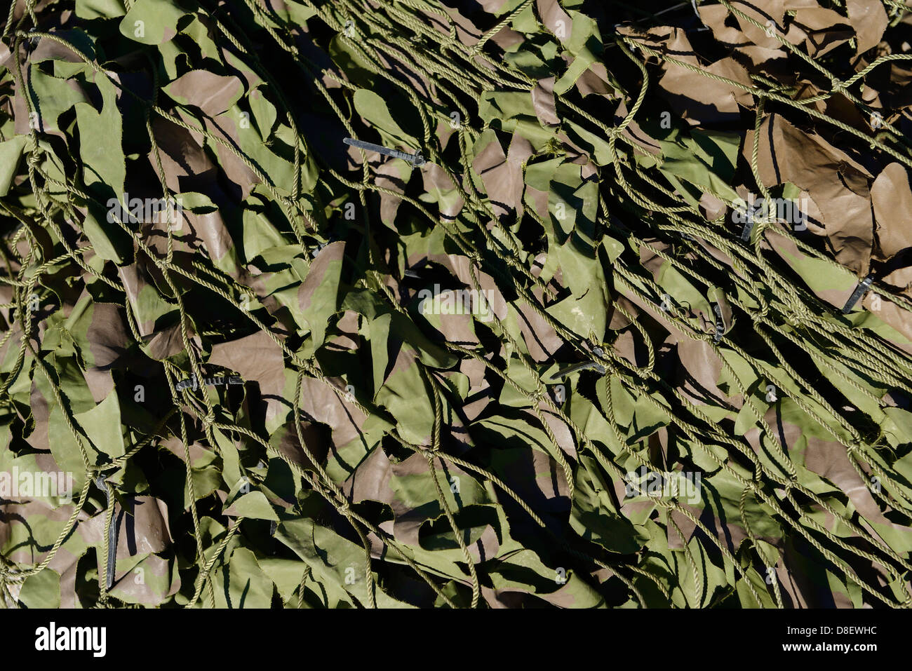 Army camouflage netting detail - Stock Image