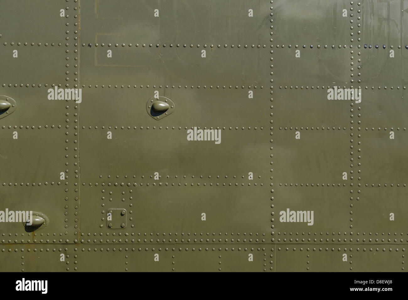 Military green metal and rivets detail - Stock Image