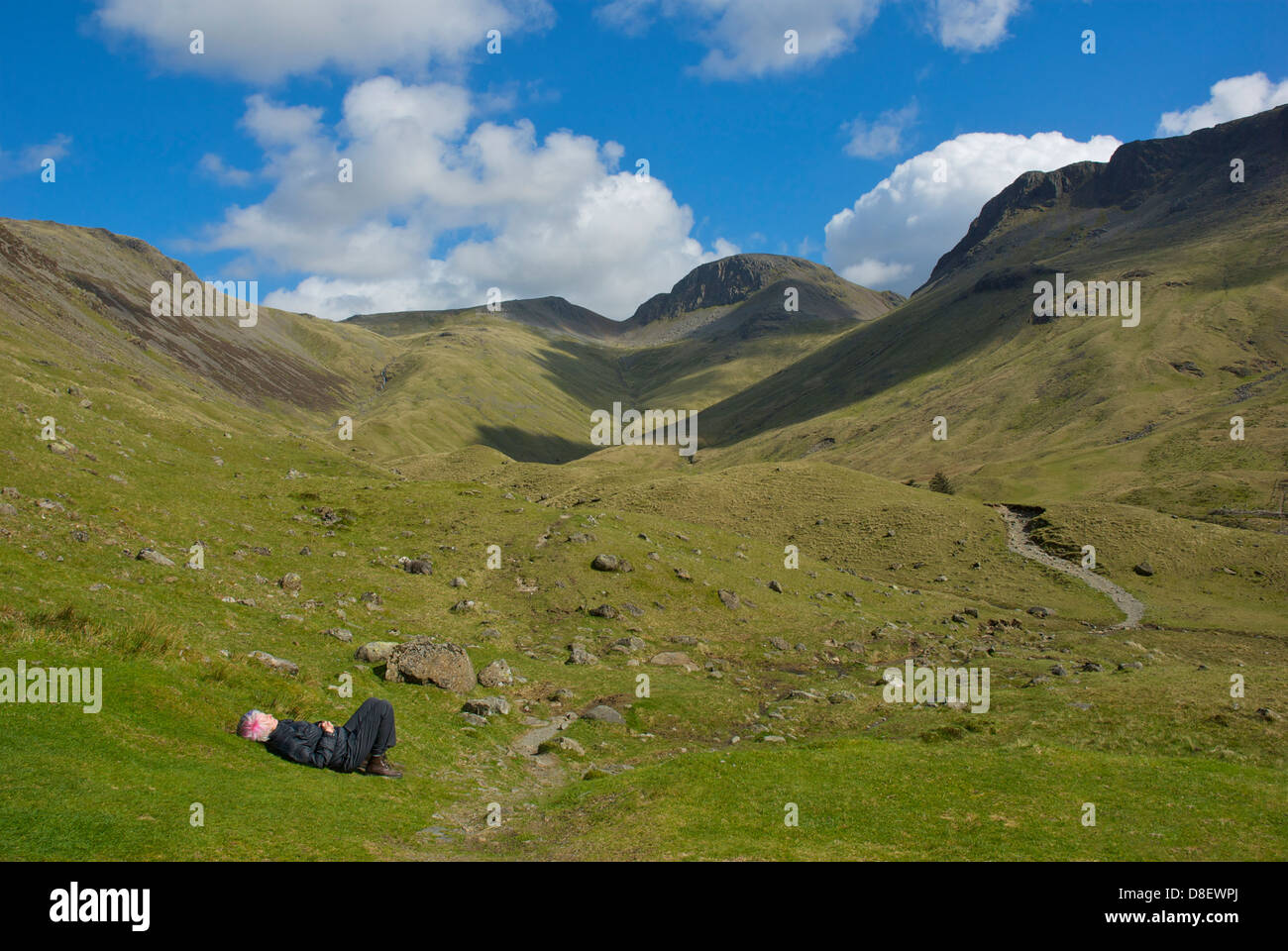 Senior female walker relaxing at Black Sail hostel, at the head of Ennerdale, Lake District National Park, Cumbria, - Stock Image