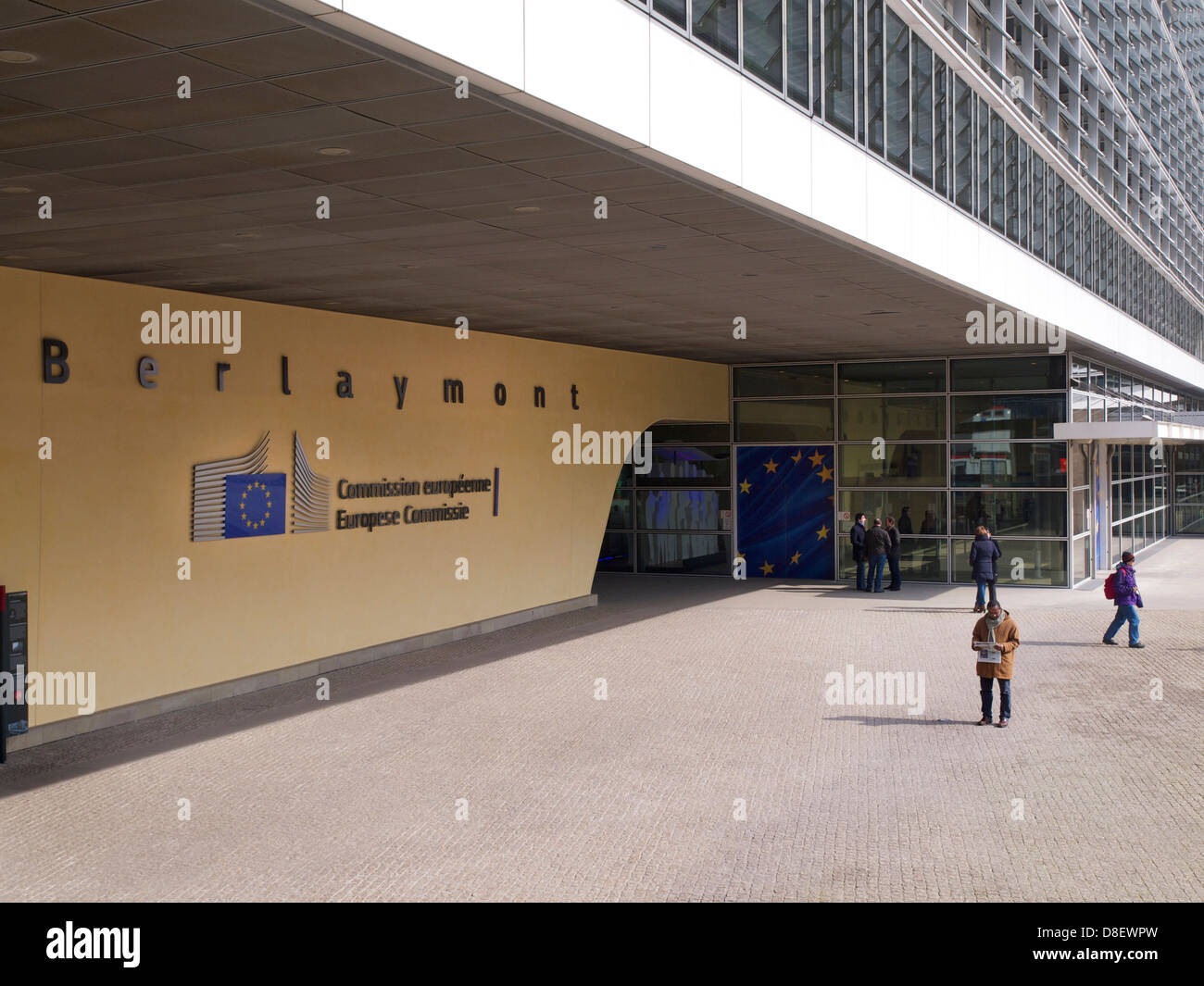 Entrance of the Berlaymont building of the European Commission in Brussels, Belgium with people - Stock Image