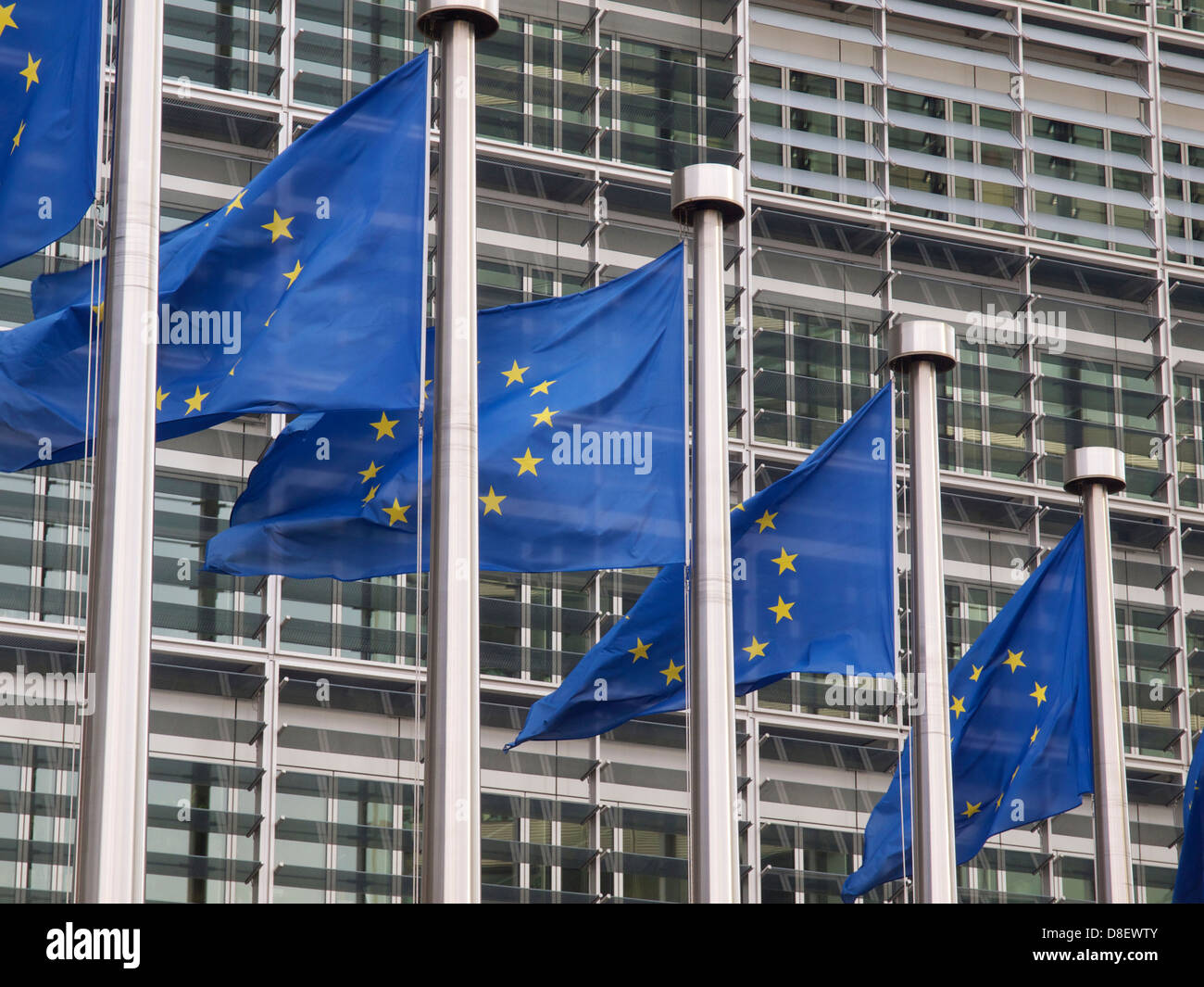 European Union flags in front of the Berlaymont building of the European Commission in Brussels, Belgium - Stock Image